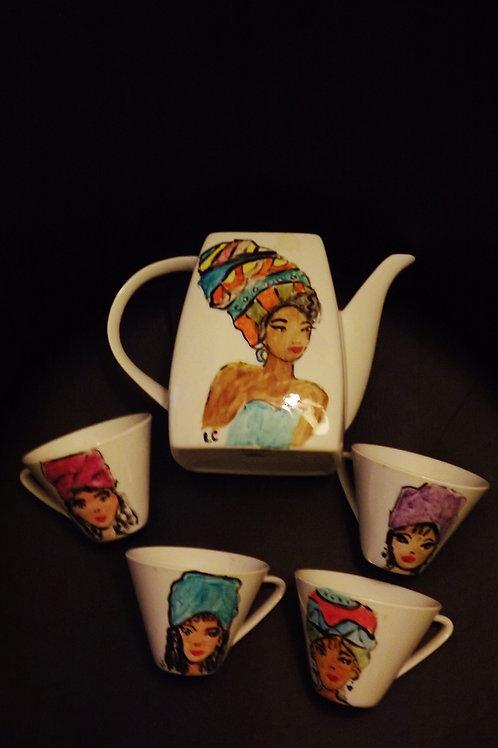 Tea set   a tea pot and  4 cups