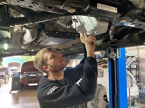 Master technician working on vehicle.
