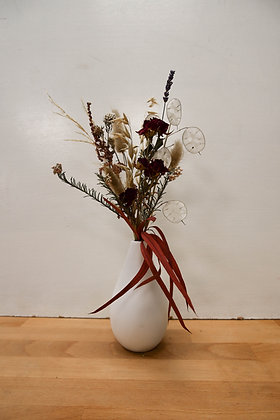 Dried flower arrangement in vase
