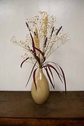 Dried flower arrangement in vase