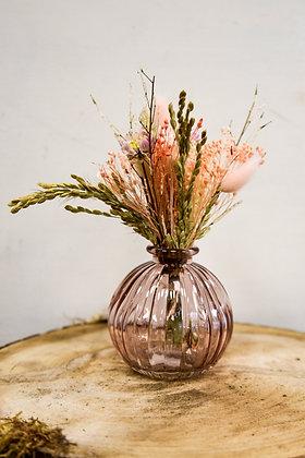 Dried flower arrangement in glass