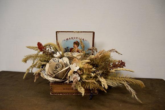 Dried arrangement in vintage container
