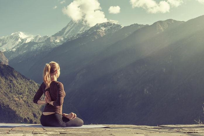 Young girl doing yoga fitness exercise o