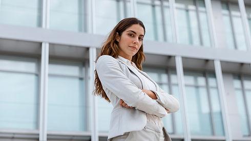 low-angle-elegant-businesswoman-posing-c