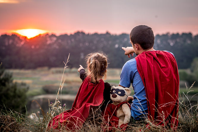 little-girl-with-dad-dressed-super-heroe