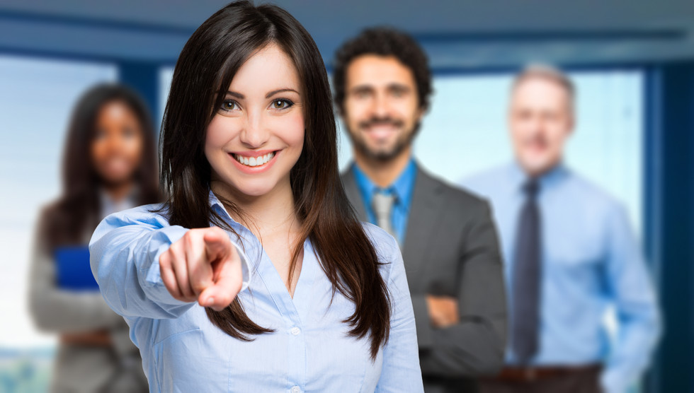 smiling-woman-pointing-her-finger-you.jp