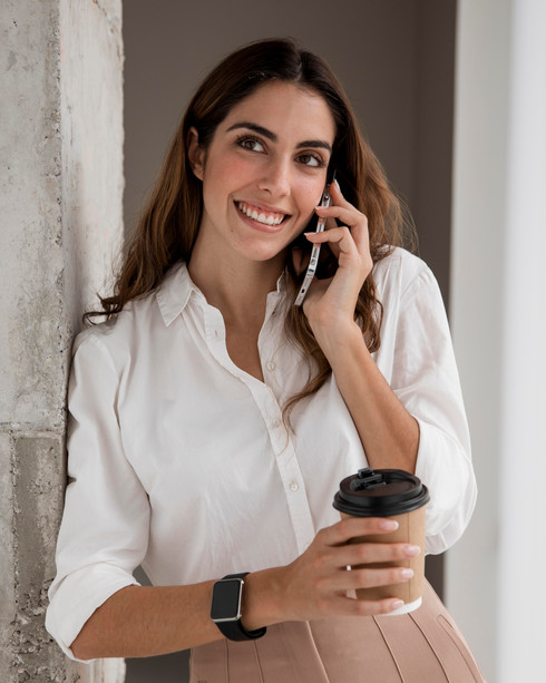 front-view-smiley-businesswoman-talking-