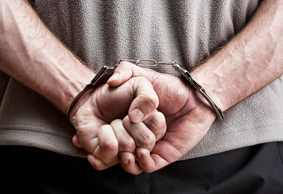 criminal-hands-locked-handcuffs-close-up-view.jpg