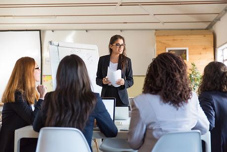 businesswomen-looking-speaker-with-paper