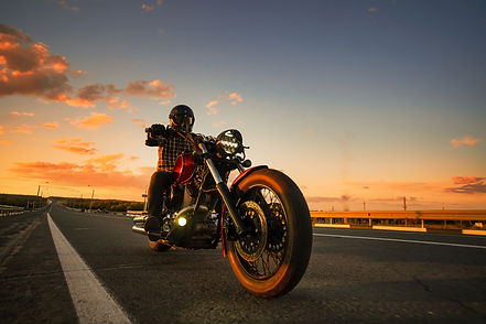 a man rides on the highway on a custom m