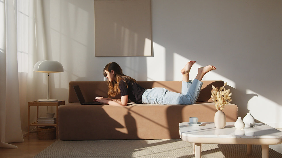 content-woman-resting-on-sofa-with-lapto