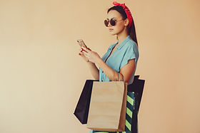 calm-woman-with-shopping-bags-using-smar
