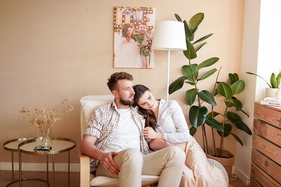 dreamy-couple-embracing-in-cozy-armchair