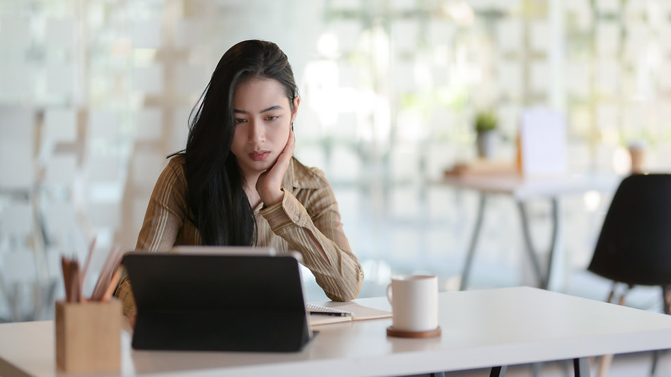 woman-in-beige-long-sleeve-shirt-sitting