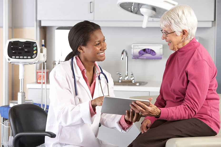 Doctor Discussing Records With Senior Fe