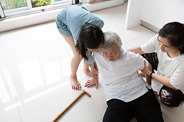 Asian elderly with walking stick on floo