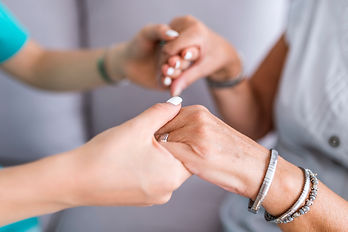 Close-up of young person's hand holding