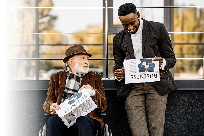 Two men chatting and reading the newspaper together