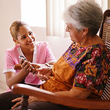 PCA supporting an elderly woman