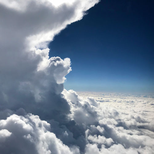 ntz_studios_clouds_building_over_gulf_of
