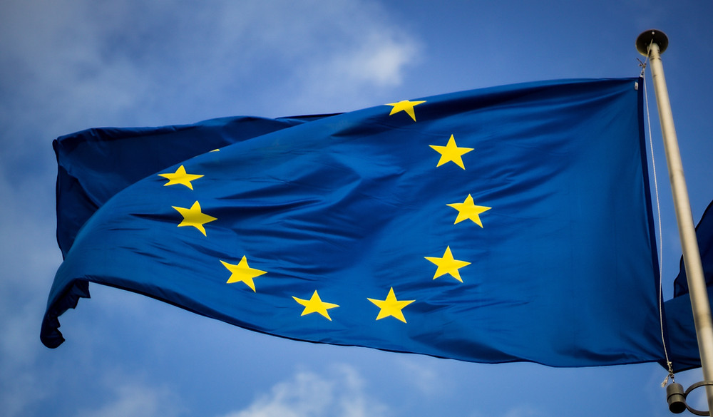 The European flag waving in the wind.