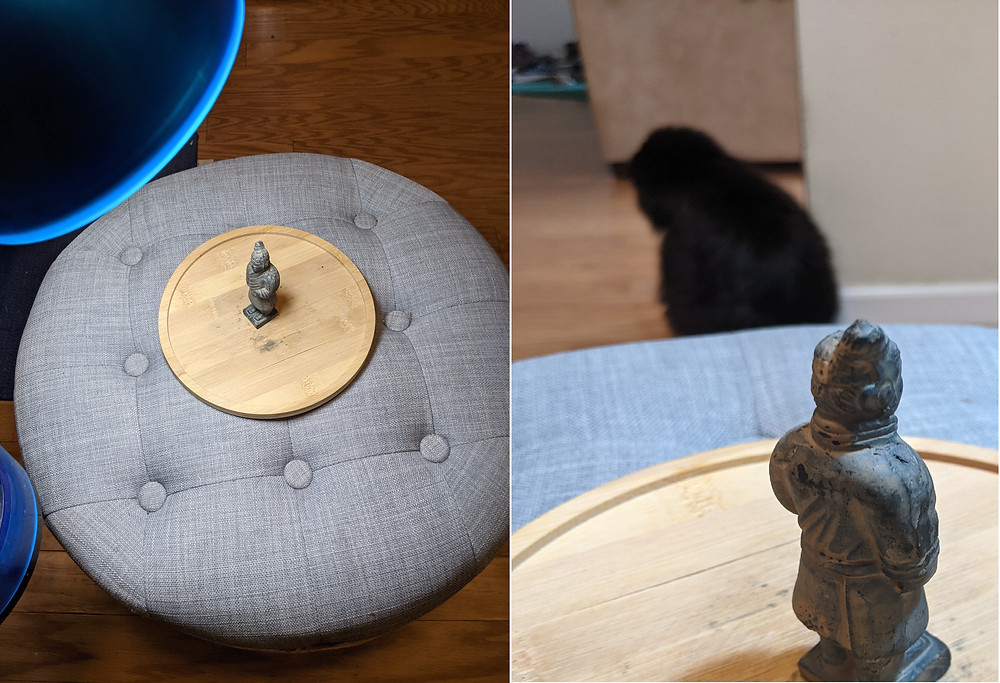 A small figure on a stool under a lamp, illustrating how to 3d scan an object.