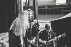 Russell performing with Jim Cuddy and Kendel Carson at Commonwealth Stadium