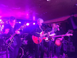 Russell performing with Tom Cochrane