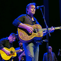 Russell backing Corb Lund