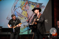 Russell performing with George Canyon
