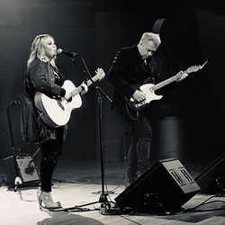 Jann and Russell performing on set of JA