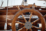 Closeup of a wheel and deck of a wooden