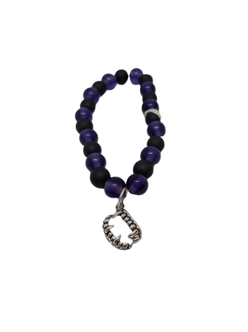 Purple stretch beaded bracelet with fang charm