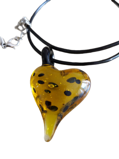 Yellow and black dotty love heart lampwork glass pendant on black cord