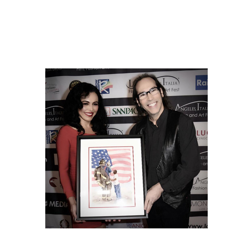 Actress Sandra Santiago with Matin Guigui presenting a painting by Pomm Hepner in Memory of 9/11