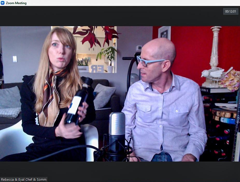 People talking with wine bottle