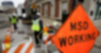 Picture of 3 Metropolitan Sewer District workers working on a sewer project in downtown Louisville, Kentucky