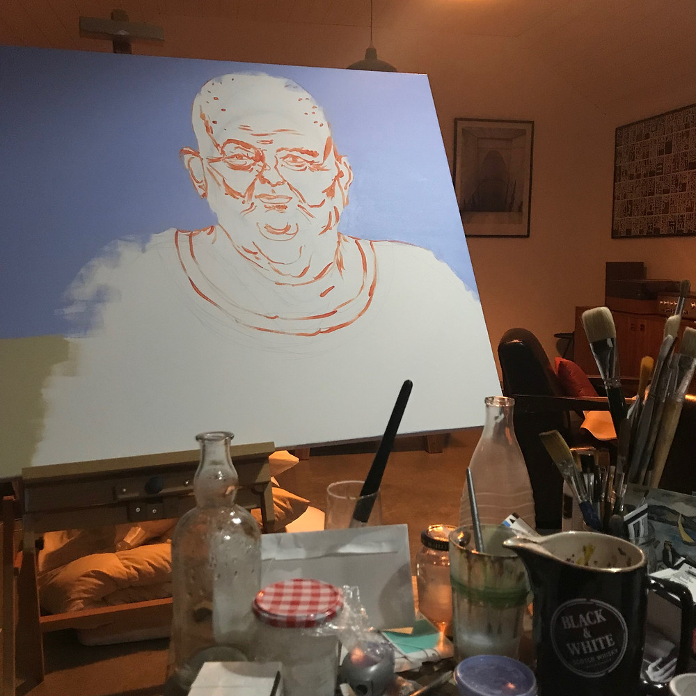 Painting of Les Murray on easel in Ray Monde studio