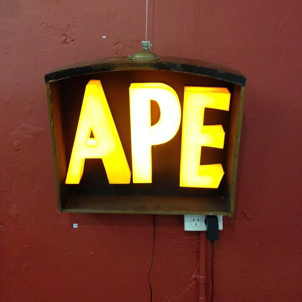 the Word APE illuminated in a drawer