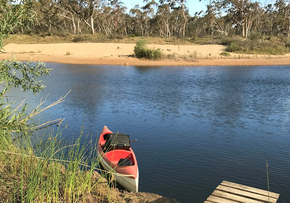 Canoe on the Shoalhaven River with luggage in it