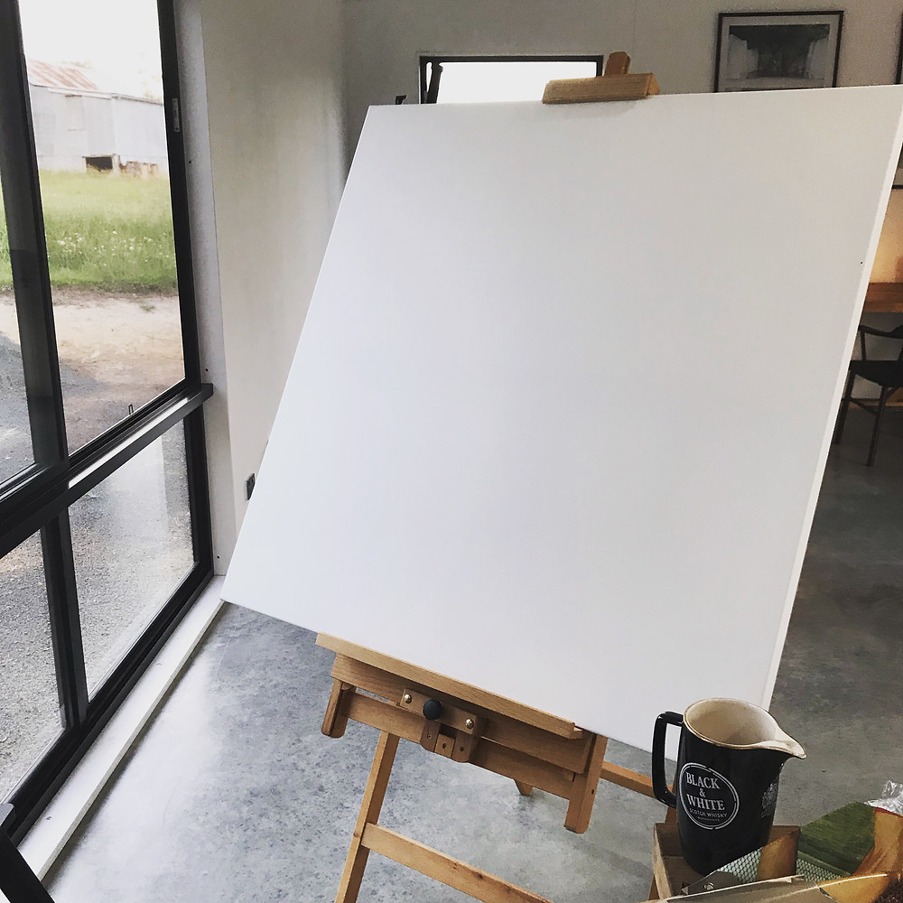 Blank canvas on easel in the studio of Ray Monde