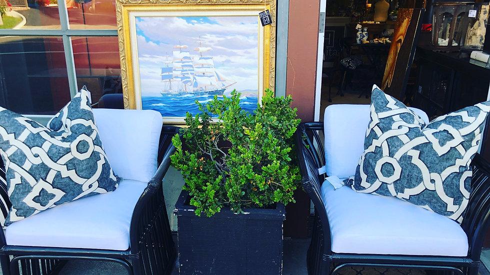 Pair of vintage black rattan chairs