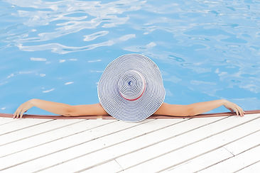 Woman relaxing by the pool.