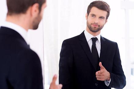 man mirror suit confident happy business