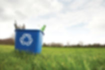 Recycling Bin In A Field