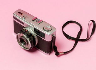 retro-styled-camera-pink-background_23-2
