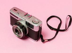 retro-styled-camera-pink-background_23-2