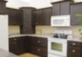 Dark brown L-shaped kitchen with island