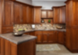 Cherry mitered kitchen cabinets with penninsula