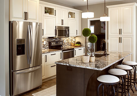 Painted white kitchen cabinets with dark island